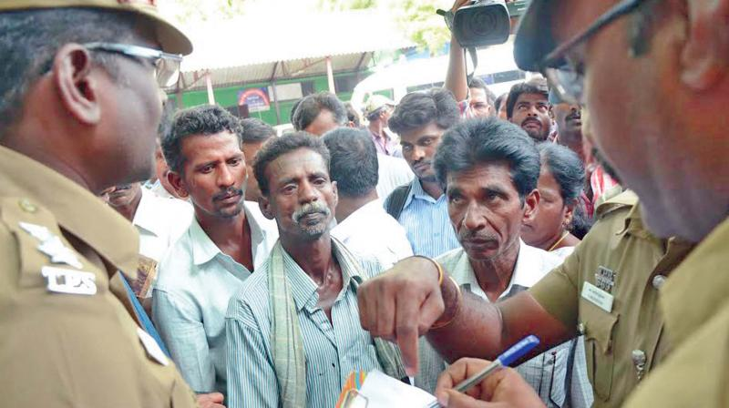 Police record the statement of Dalit youth Shankar's father Velusamy at the CMCH on Monday.  (Photo: DC)