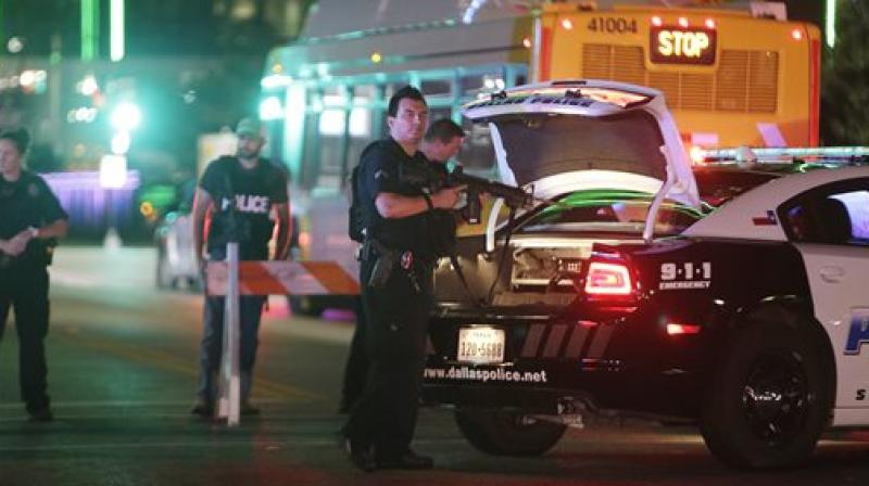 Police block streets in downtown Dallas early as law enforcement investigate the scene of Thursday's fatal shooting. (Photo: AP)