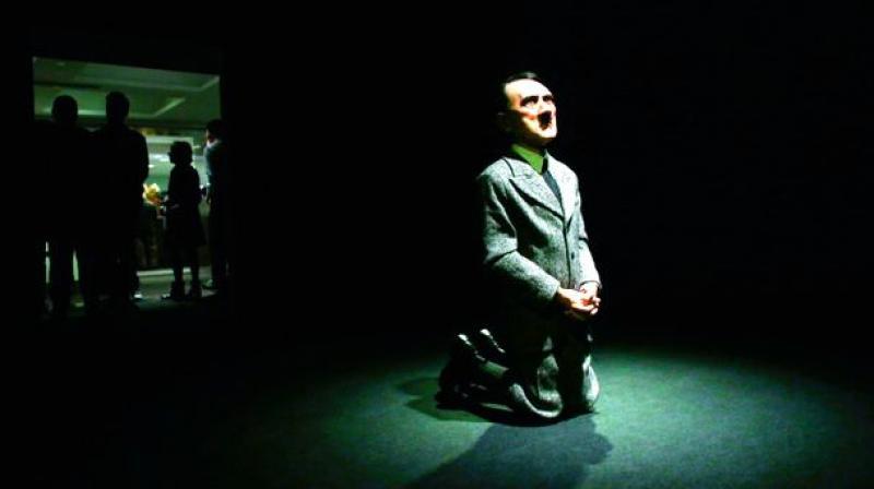 Maurizio Cattelan's Hitler statue, Him. (photo: Via web)