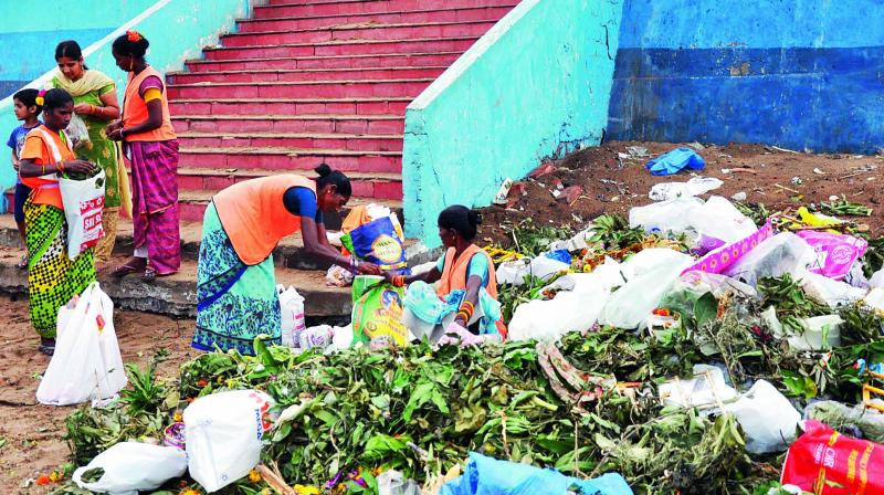 GVMC workers clean garbage at various Ganesh pandals near Ramakrishna Beach on Thursday.