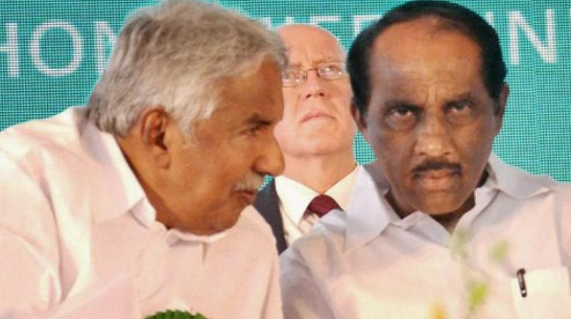 Kerala Chief Minister Oommen Chandy with Excise Minister K Babu (Photo: PTI)