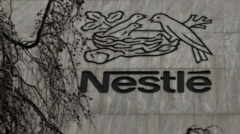 Nestle says it may adjust its portfolio of brands to fit in with its new strategy.