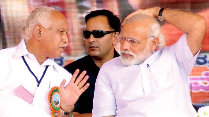 PM Narendra Modi and BJP state president B.S. Yeddyurappa in Davangere on Sunday. (Photo: KPN)