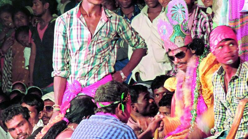 A scene from Natak performed by the Adivasi youth at Nagoba Jatara on Thursday. (Photo: DC)