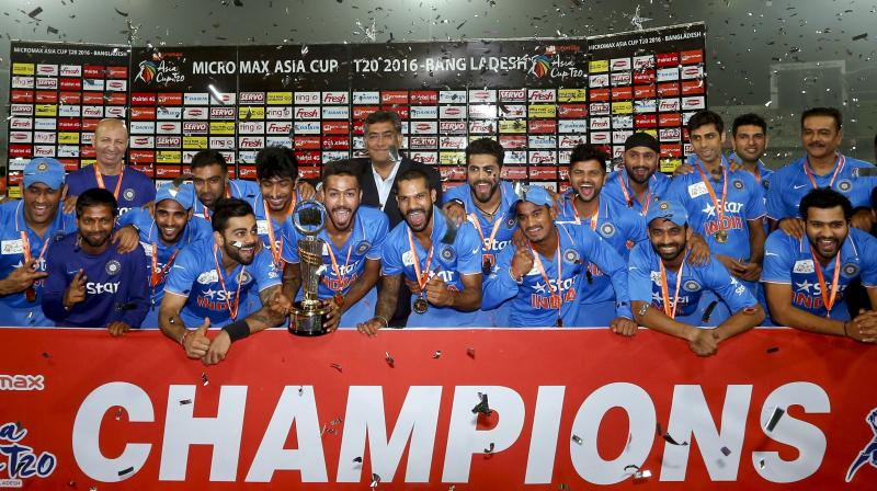 India won the Asia Cup with an eight-wicket triumph over hosts Bangladesh on Sunday as opener Shikhar Dhawan returned to form with a half-century in a 94-run stand with Virat Kohli in a rain-hit final. (Photo: AP)