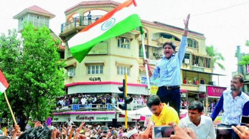 File photo of Patidar community leader Hardik Patel leading a rally for reservation in Ahmedabad (Photo: PTI)