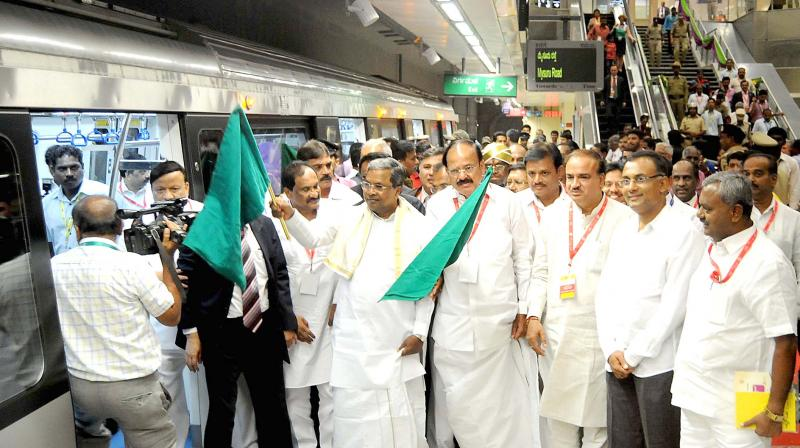 Chief Minister Siddaramaiah and Union minister Venkaiah Naidu flag off the underground stretch of the Metro's East-West corridor, in Bengaluru on Friday. (Photo: Shashidhar B.)