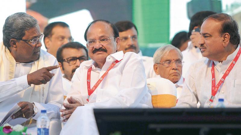 Chief Minister Siddaramaiah and Union Ministers Venkaiah Naidu and Ananth Kumar inaugurating the East-West Metro corridor line at Vidhana Soudha in Bengaluru on Friday.