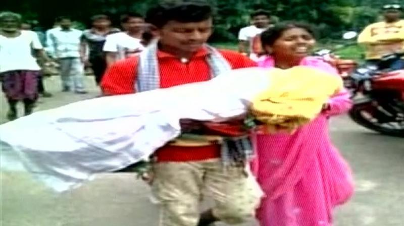 Dinabandhu Khemudu and his wife carrying their daughter's body. (Photo: ANI Twitter)