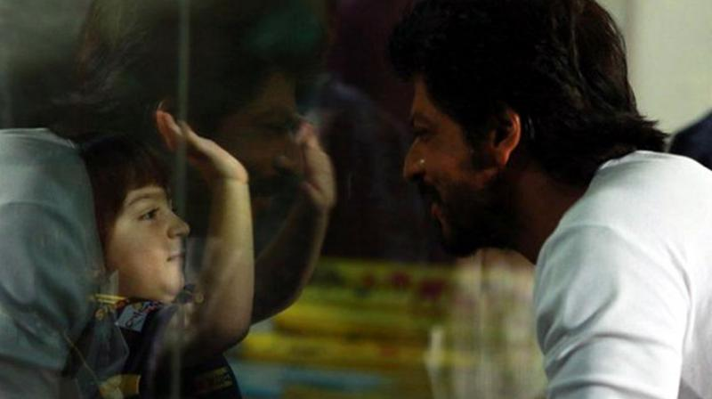 Bollywood star Shah Rukh Khan and his son AbRam, attended the ongoing IPL matches to cheer for their team Kolkata Knight Riders, as they took on Kings XI Punjab, at Eden Gardens on Wednesday. Photo: Twitter