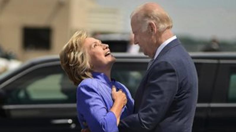 Hillary Clinton laughs as Joe Biden hugs her in Scranton. (Photo: AP)