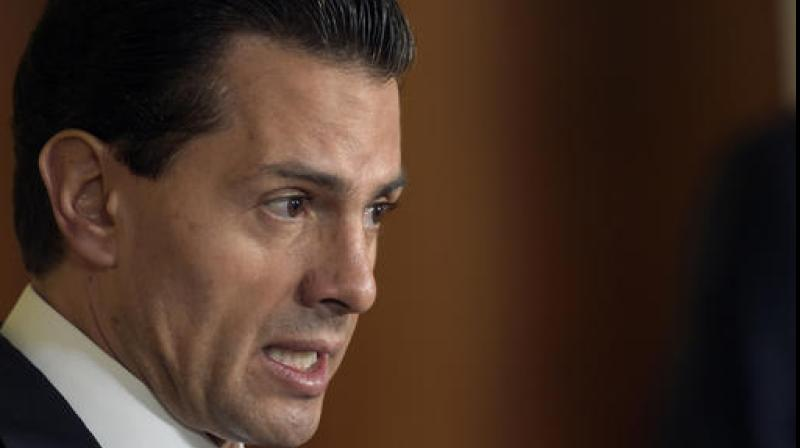 """In a recorded address televised nationally, Pena Nieto said """"I regret and reject the decision of the US to build the wall."""" (Photo: AP)Mexican President Enrique Pena Nieto. (Photo: AP)"""
