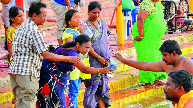 Pilgrims collection holy Krishna water in bottles. It is believed that people who missed Pushkaralu can sprinkle water which is equal to taking a dip in Pushkaralu.