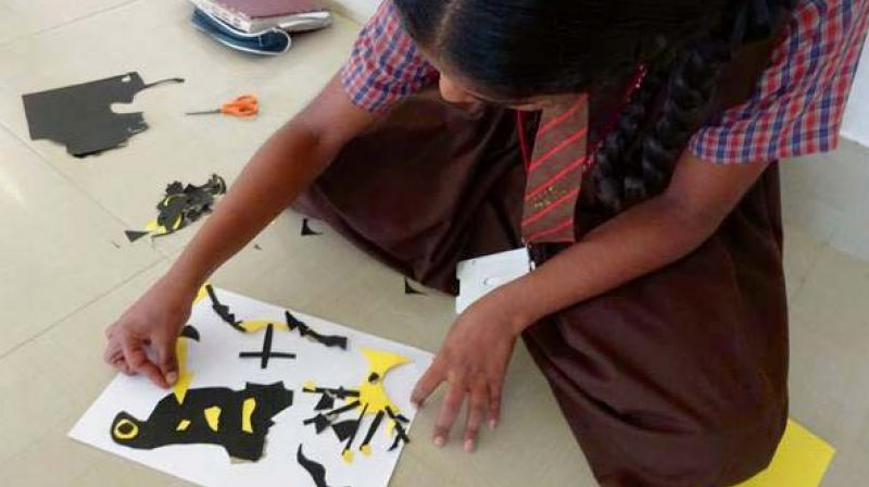 A girl from ArtSparks Foundation indulges in education through art.
