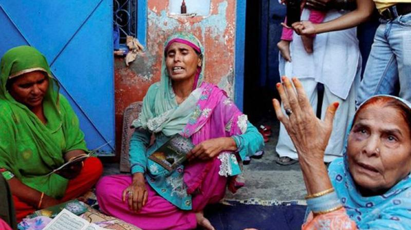 The family of Akhlaq, who was beaten to death by a mob, at Bishada. (Photo: PTI)