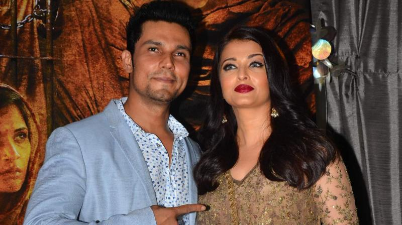 Randeep Hooda and his leading lady Aishwarya Rai Bachchan, came together to celebrate the success of their film 'Sarbjit' at the box office. Photo: Viral Bhayani