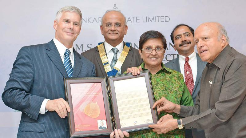 Dr David Bergvinson, director general, ICRISAT, Hyderabad, receives  Dr M.S. Swaminathan award for environment protection, 2016, from  Puducherry Lt Governor Kiran Bedi on Monday. (Photo: DC)