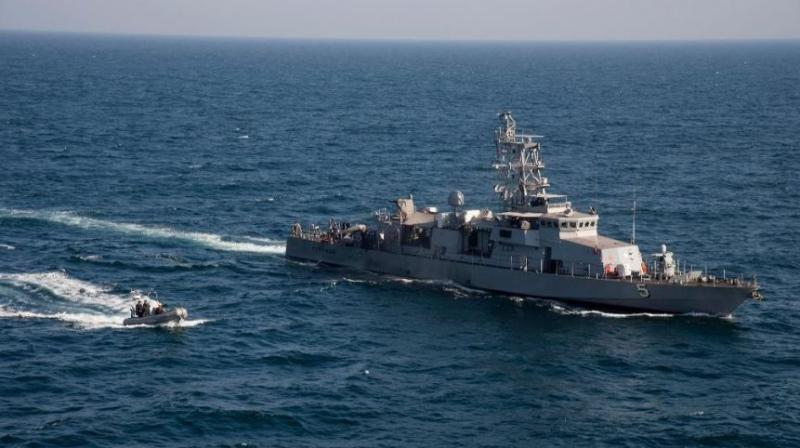 The most dramatic moment in Wednesday's three events occurred when an Iranian Revolutionary Guard Corps boat maneuvered around two US patrol ships, the USS Squall and USS Tempest. (Photo: AP)