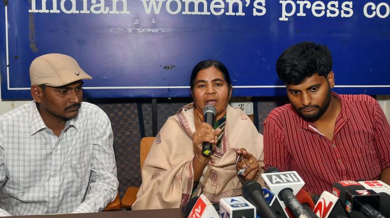 Dalit research scholar Rohith Vemula's mother Radhika and his brother (L) with Prasanth Dontha, a student expelled from Hyderabad University, at a press conference in New Delhi. (Photo: PTI)