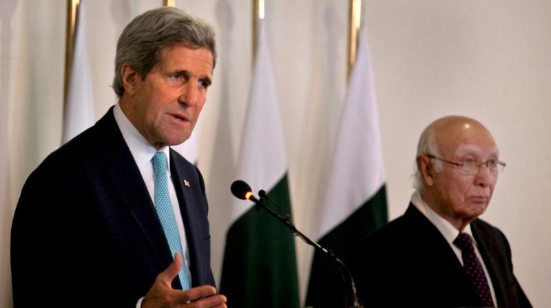 U.S. Secretary of State John Kerry speaks as Pakistani Prime Minister's Adviser on Foreign Affairs Sartaj Aziz looks on. (Photo: AP)