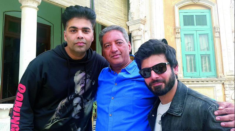 Karan Johar and Fawad Khan pose with television actor Kaushal Kapoor.