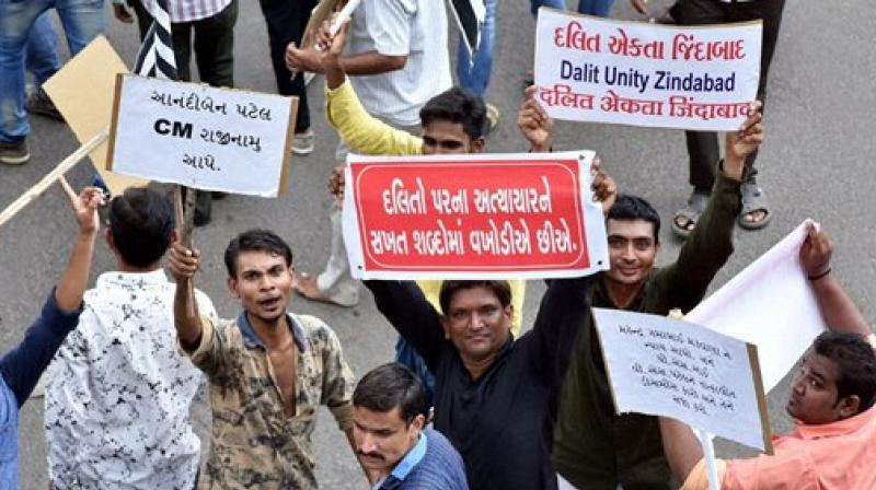 Members of the Dalit Community during their protest in Surat. (Photo: PTI)