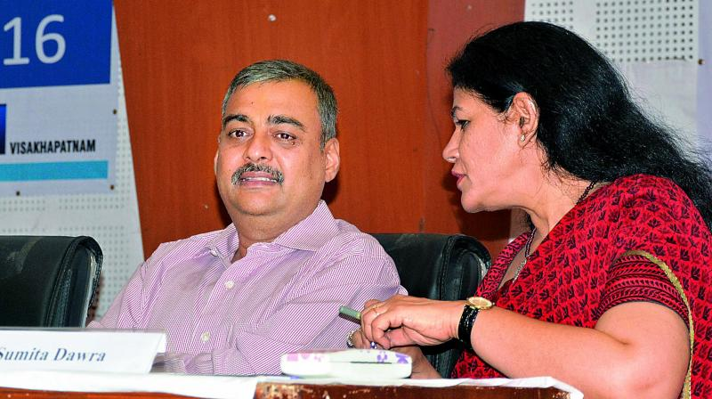 Vizag police commissioner Amit Garg has a word with higher education principal secretary Sumita Dawra during a conclave at YVS Murthy Auditorium of AU Engineering College in Vizag on Friday.