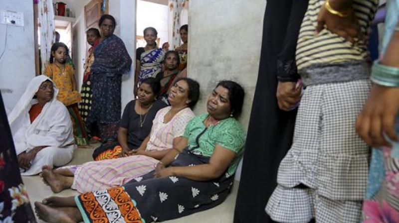 Neighbors and relatives visit the family members of a victim who died after a massive fire broke out at Puttingal temple. (Photo: PTI)