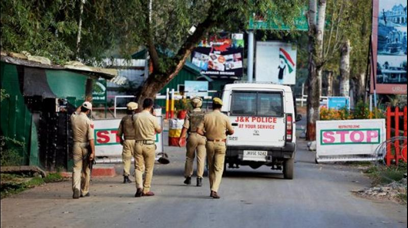 Special Operation Group of Jammu and Kashmir Police personnel move inside the Army Brigade camp during a terror attack in Uri, Jammu and Kashmir on Sunday. (Photo: PTI)