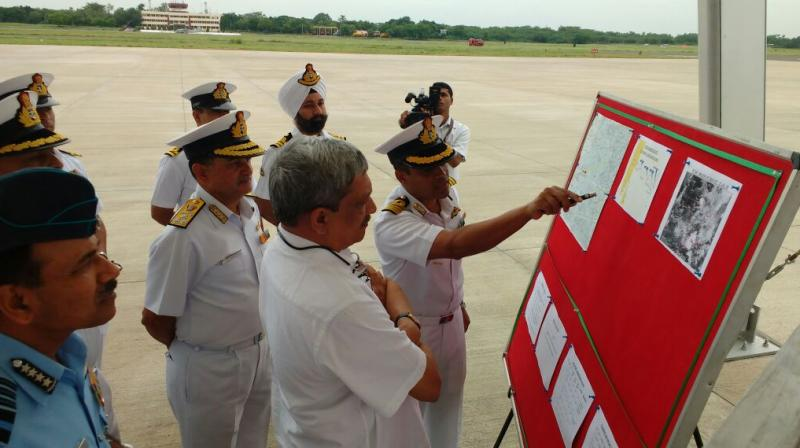 Defence Minister Manohar Parrikar being briefed on search ops of missing IAF AN-32 at Naval Air station INS Rajali. (Photo: ANI/Twitter)