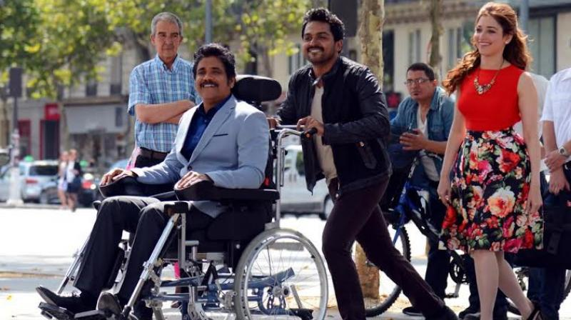 A still of Nagarjuna, Karthi and Tamannah in the film 'Thozha'.