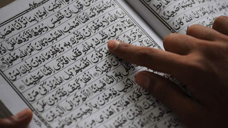 Pooja Kushwaha's efforts to teach the Quran for free to Muslim students has been appreciated by others. (Photo: AFP)