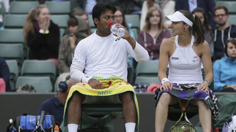 Heather Watson and Henri Kontinen sailed past defending mixed doubles champions Leander Paes and Martina Hingis 3-6, 6-3, 6-2. (Photo: AP)