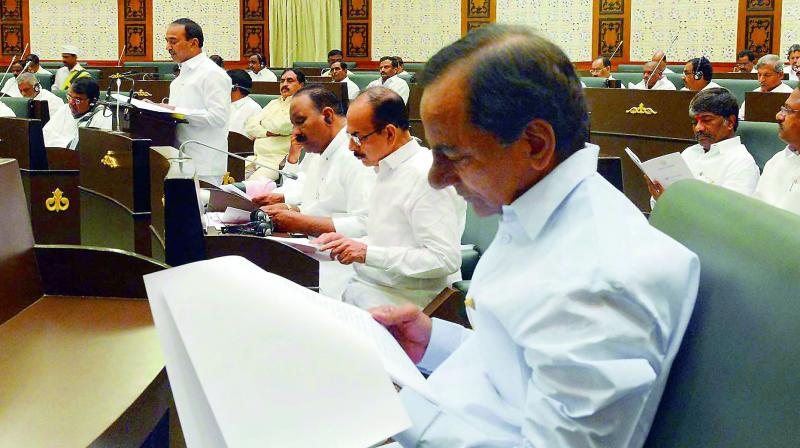 Chief Minister K. Chandrasekhar Rao goes through the Budget speech as finance minister Etela Rajender presents it in the TS Assembly on Monday.