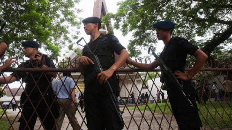 Indonesian police officers guard a church compound following an attack during Sunday Mass in Medan. (Photo: AP)