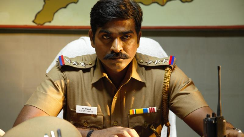 Vijay Sethupathi's moves are full of energy and enthusiasm and his impeccable dialogue delivery is a treat to watch.