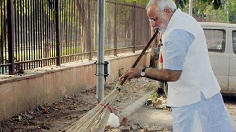 Prime Minister Narendra Modi wields the broom during a surprise visit to the Mandir Marg Police Station after launch of 'Swachh Bharat Abhiyan' in New Delhi on Thursday. The nationwide campaign aims to clean up India in five years. (Photo: File/PTI)