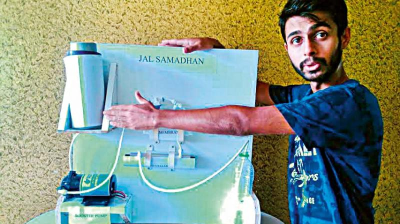 Rakshit Prabhakaran of BMS College of Engineering in Bengaluru with his water purifier. (Photo:  DC)