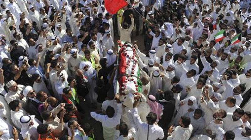 Thousands of Sunnis and Shiites from across the country take part in a mass funeral procession for 27 people killed in a suicide bombing, by a sympathizer of the Islamic State group, that targeted the Shiite Imam Sadiq Mosque a day earlier, at the Grand Mosque in Kuwait City, Kuwait. (Photo: AP)
