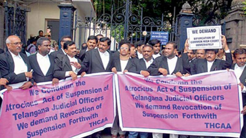 Telangana advocates protest in front of Hyderabad High Court against the suspension of two judges for taking out a rally over what they called injustice done to Telangana state in splitting of judges. (Photo: DC)