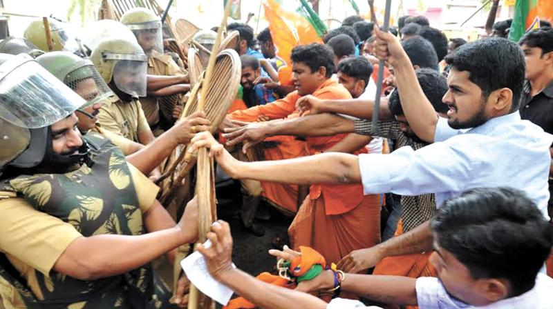 The slug fest between police and Yuvamorcha members during the Yuvamorcha march to the Century dental college, Poinachy in Kasargod on Tuesday. The march was in connection with the alleged IS link of the missing persons as two among them were the student of the college By arrangement