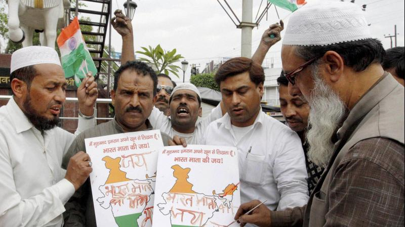People from Muslim community write 'Bharat Mata ki jai' with their blood as a way to show their disapproval with MIM's chief Asaduddin Owaisi's recent comment to not raise that slogan, in Meerut. (Photo: PTI)