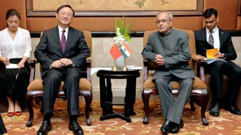 Pranab Mukherjee with State Councillor, Yang Jiechi during a meeting at Beijing in China. (Photo: PTI)