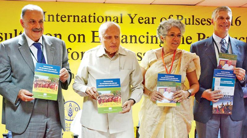 Dr. Mohmoud Solh director general of ICARDA, Beirut, receives the first copy of a booklet on 'Pulses in meeting the zero hunger challenges', released at the foundation day and inauguration of consultation on enhancing the productivity and profitability of pulses for addressing food and nutrition security, at MSSRF in the city on Sunday. Professor M.S. Swaminathan, founder MSSRF, Dr Madhura Swaminathan, chairperson MSSRF, and Dr David Bergvinson director general of ICRISAT, Hyderabad, are seen. (Photo: DC)