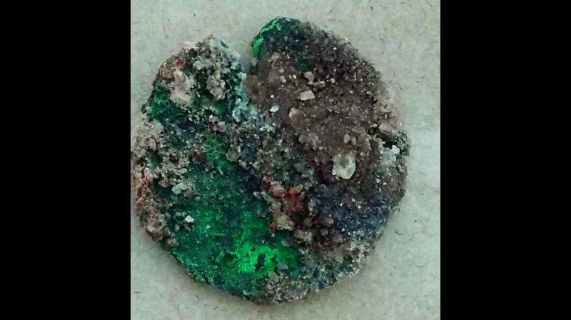 Archaeologists on Wednesday unearthed coins and a crystal conearium rod