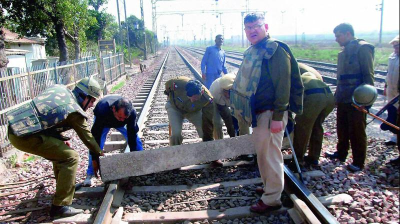 Police remove blockage from railway track during the protest of jat community for reservation, in Faridabad on Sunday. (Photo: PTI)