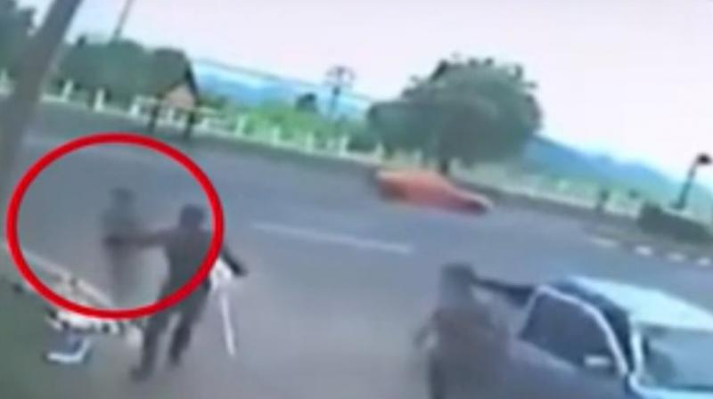 The CCTV footage reveals how she was fatally knocked off the motorbike by a car and crashed into a power-pole and thrown to the ground. (Credit: YouTube)
