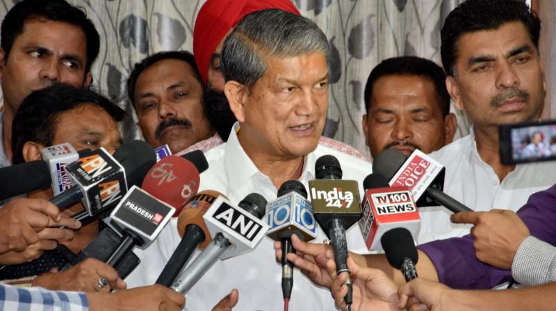 Ousted Uttarakhand Chief Minister Harish Rawat at a press conference. (Photo: PTI)