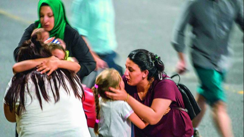 Children and their relatives embrace as they leave Ataturk airport shortly after the attacks 	(Photo: AFP)
