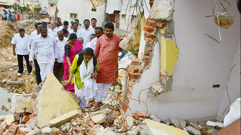 BJP leader R. Ashok visits areas affected by the demolition drive, in Bengaluru on Monday. (Photo: DC)